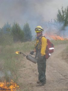 Heidi Bailey participating in a controlled burn